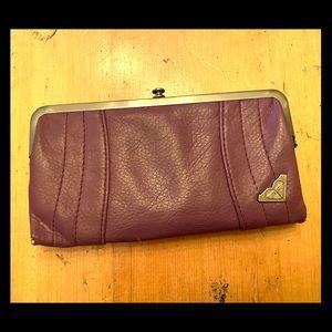 Roxy plum colour, multi pocket wallet.